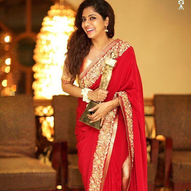 Poornima Indrajith in red saree
